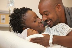 A couple with a newborn baby in the hospital