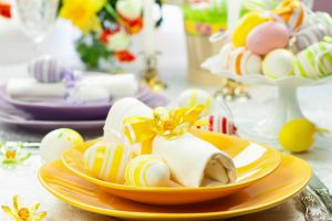 A dining table with Easter decorations and table settings
