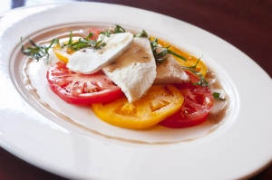 A Caprese salad on a white plate