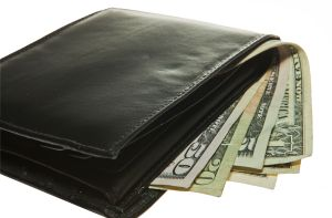 A black leather wallet with money inside of it