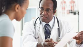 A male doctor talking to his female patient