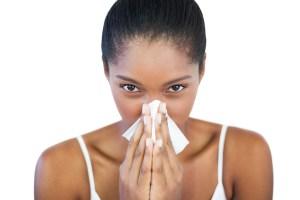 woman-sneezing-into-tissue