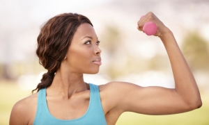 A woman doing a bicep curl