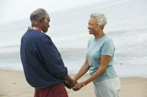 Older couple holding hands at the beach