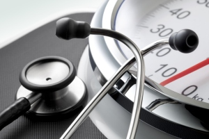 A stethoscope on top of a scale