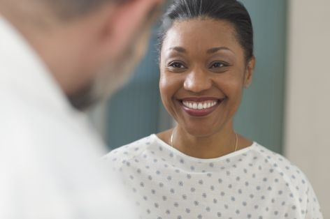A woman patient smiling at doctor