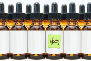 Rows of Dropper Bottles with One Marked Poison