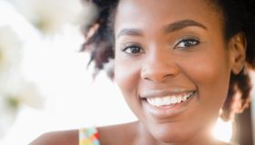 A pretty woman with natural hair smiling