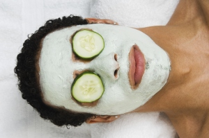 A man receiving spa facial treatment