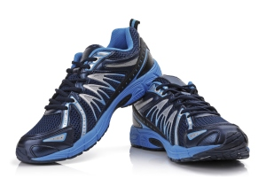 A pair of a blue and black running shoes