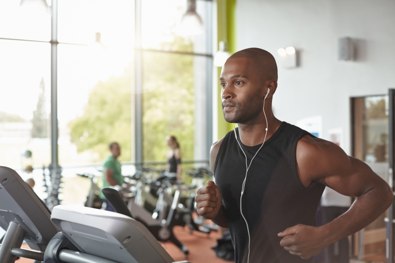 Man in a gym running on a treadmill