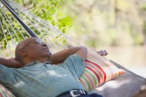 A senior man laying in hammock