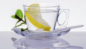A cup of water with lemon