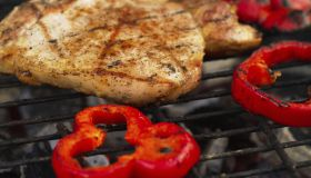 Red peppers and chicken on a grill