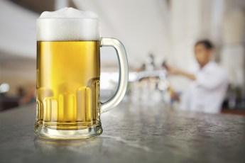 A mug of light beer in a pub