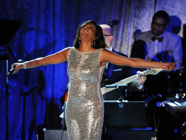 Singer Whitney Houston performs onstage