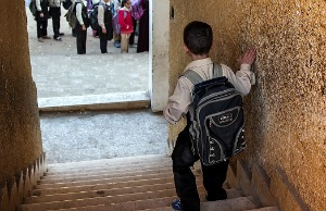 boy walking down stairs