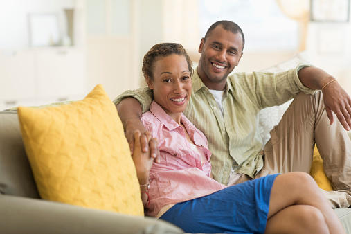 Black couple on couch