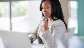 Black woman sitting at desk